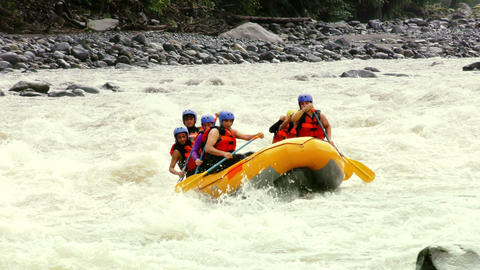 group of six young people whitewater rafting Footage