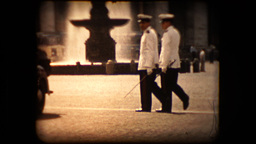 Unknown Italian military guards or police cross a street in antique footage Live Action