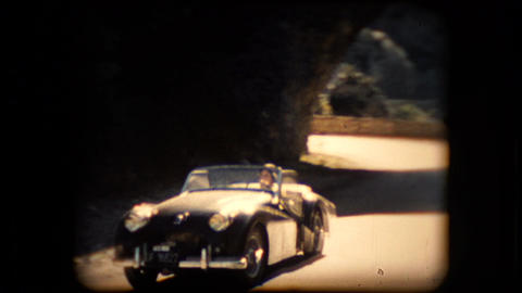 Footage of a TR2 Triumph roadster sports car Footage