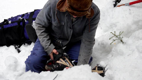 Forestry worker who fell off their shoe boots a dead body in the snow after an a Footage