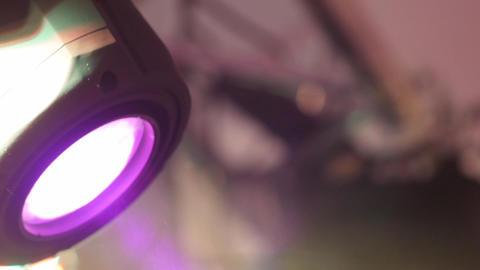 Reflector with colored light that moves over a metal scaffolding in during a sho Footage
