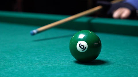 Man In Billiards Shoots Orange Ball In Pocket Slow Motion Footage