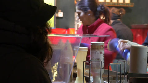 Woman ordering a cake at a kiosk in the the Christmas Fair and expects to receiv Footage