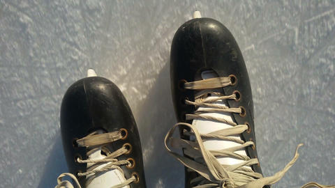 Close-up of hockey skates on the ice slide Filmmaterial