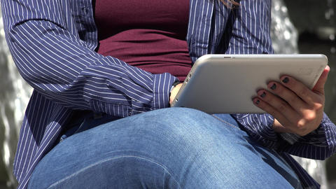 Woman Using Smart Device Or Tablet Live Action