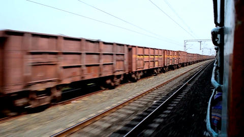Indian Moving goods train running side by side