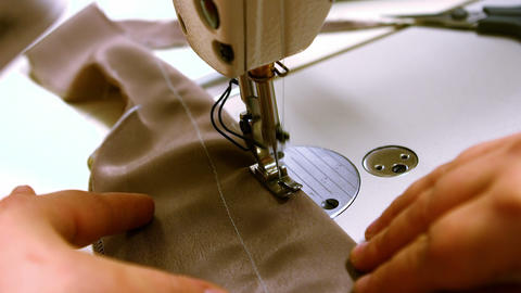 Seamstress stitching cloth on sewing machine Live Action