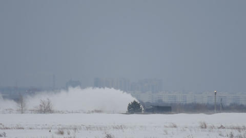 Snowplow clears the runway Footage
