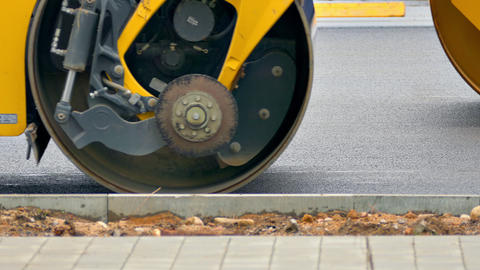 4K Pavers and Rollers Repair Asphalt Road in City Footage