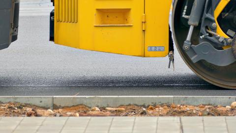 4K Pavers and Rollers Repair Asphalt Road in City Footage