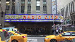 Yellow taxi cabs by Radio City Music Hall Footage