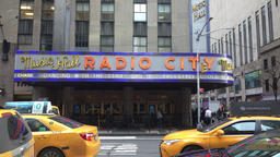 Yellow taxi cabs by Radio City Music Hall Stock Video Footage