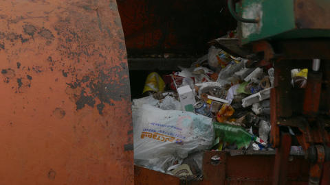 4K Ungraded: Dirty Robotic Arm of Side Loader Garbage Truck Throws Junk Into Footage