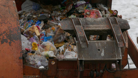 4K Ungraded: Dirty Garbage Truck Compresses Junk Inside Waste Container on A Footage