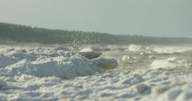 Slow motion of waves crushing on frozen shore Footage