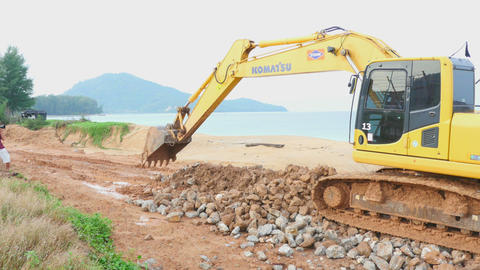 Excavator working on beach Footage