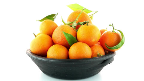 Tangerines on clay bowl Footage