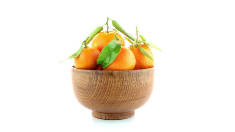 Tangerines on wooden bowl Footage