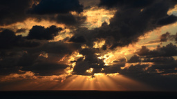 Sunset with clouds and sunrays over the ocean, time lapse Footage