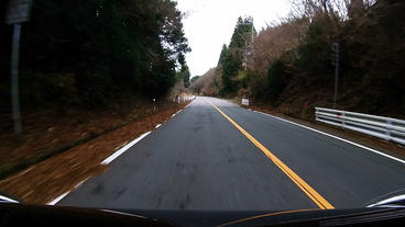 Bonnet view. The car is accelerating in the downhill Footage