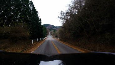 Bonnet view. The car running uphill at low speed Footage