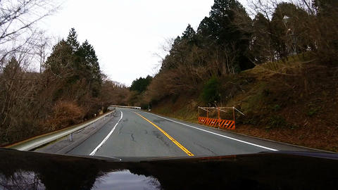 Roof View. Car is traveling on a mountain road slowly Footage