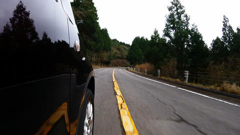 Side door view. The car will run over the undulating road surface Footage