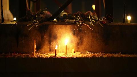 Beautiful candles burning in buddhist shrine Footage