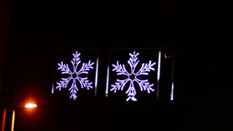 Snowflakes christmas decoration over a road with streep lamp, loopable Footage