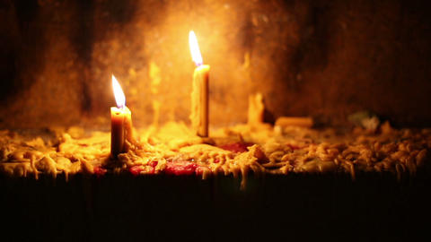 Beautiful dramatic burning candles and melting wax Footage