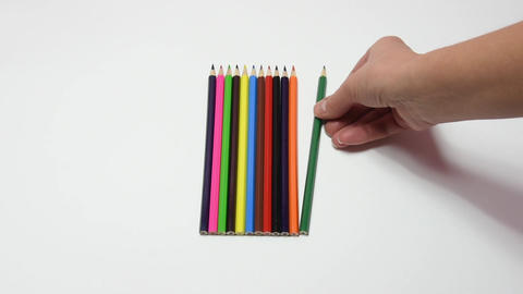 Hand pencil corrected by applying it against the other pencils, close-up, white  Footage
