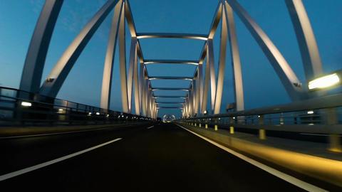 Slow motion POV through Tokyo Gate Bridge during twilight ビデオ