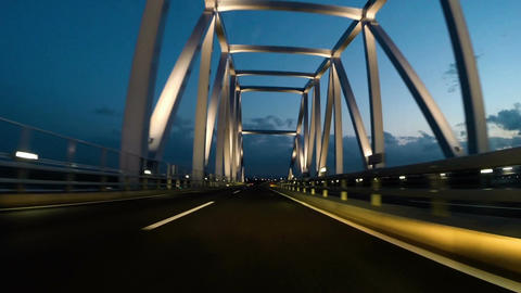 Twilight POV drive through the arches of Tokyo Gate Bridge Image