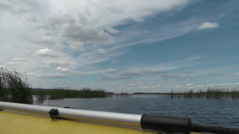 Big river to the horizon. Aboard of inflatable boat with paddle in the foregroun Footage