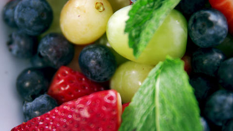 Various fruits and herbs in bowl Stock Video Footage