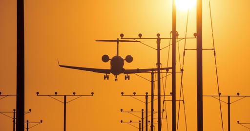 Jet Landing At Airport At Sunset Footage