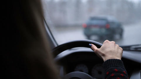 Woman holding steering wheel firmly with hand Footage