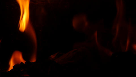 Close up of fire burning in stove slowmotion 96 frames per second 52 Footage
