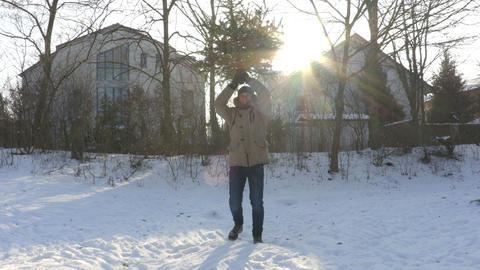 Man dancing with Christmas Tree Footage