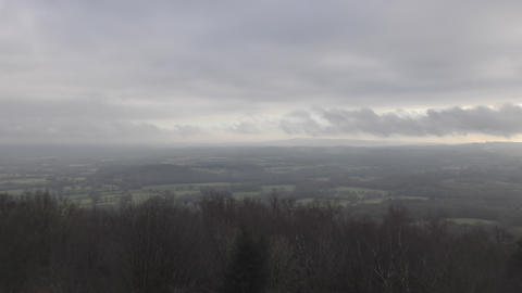 Time lapse. View of the clouds over the forest and fields Footage