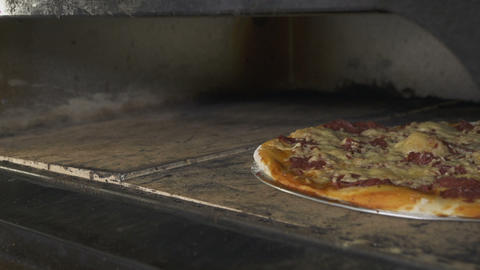 Somebody Takes Pizza out of Oven with Special Shovel Footage