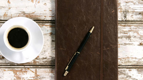 Diary with pen, cup of coffee and smartphone Footage