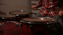 Young drummer playing at drum set Footage