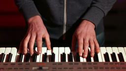 Man hands playing electronic keyboard on stage Footage