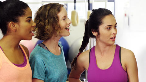 Beautiful women interacting with each other in fitness studio Footage