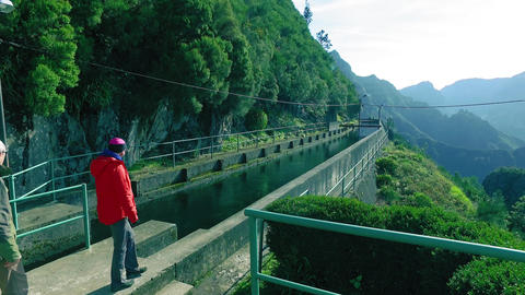 Tourists Walking on Hiking Pathway Levada Waterway Footage