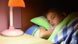 Man's hand turned out the light from a table lamp in crib fallen asleep girl Live Action