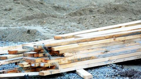 Forklift loading wooden plank Live Action