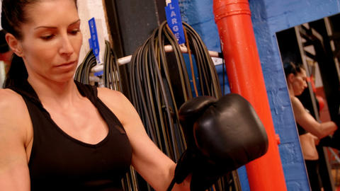Female boxer wearing boxing gloves Live Action