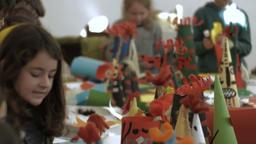 Pernik, Bulgaria January 28, 2017: Children making carnival masks for Surva fest Footage